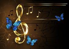 Μουσικό κλειδί με τις μπλε πεταλούδες στοκ εικόνες