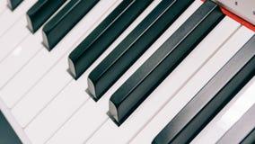 Μουσικό όργανο συνθετών κλειδιών ηλεκτρονικό με τα κλειδιά Επαγγελματικό μουσικό όργανο Η σύσταση ταινιών & Στοκ Εικόνα