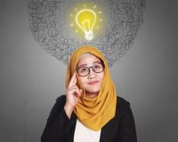 Μουσουλμανική επιχειρηματίας που παίρνει την ιδέα στοκ φωτογραφία