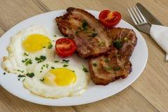 Μπέϊκον και αυγά για το πρόγευμα Στοκ Εικόνα