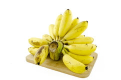 Μπανάνες στο ξύλο που απομονώνεται στο άσπρο υπόβαθρο Στοκ Φωτογραφίες