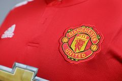 ΜΠΑΝΓΚΟΚ, ΤΑΪΛΑΝΔΗ - 12 ΙΟΥΛΊΟΥ: Το λογότυπο της Manchester United Footb Στοκ Εικόνες
