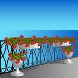 Μπαλκόνι με τα γεράνια Στοκ Φωτογραφίες