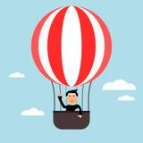 Μπαλόνι ζεστού αέρα με ένα άτομο Στοκ Φωτογραφίες