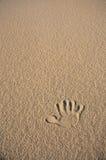 μπεζ άμμος τυπωμένων υλών χεριών ενιαία Στοκ Εικόνες