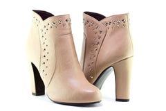 Μπεζ μπότες για τις γυναίκες Στοκ εικόνα με δικαίωμα ελεύθερης χρήσης