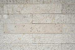 Μπεζ τεχνητός πέτρινος τοίχος Στοκ εικόνα με δικαίωμα ελεύθερης χρήσης