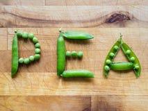 ΜΠΙΖΕΛΙ λέξης που γράφεται με τα μπιζέλια Στοκ εικόνες με δικαίωμα ελεύθερης χρήσης