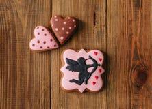 Μπισκότα διακοπών που παγώνουν το δώρο καρδιών τόξων βελών αγγέλου Στοκ Εικόνα