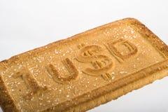 Μπισκότα με τα σύμβολα νομίσματος Στοκ φωτογραφίες με δικαίωμα ελεύθερης χρήσης