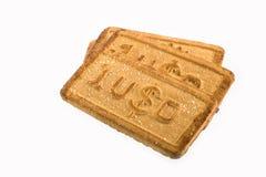 Μπισκότα με τα σύμβολα νομίσματος Στοκ εικόνες με δικαίωμα ελεύθερης χρήσης