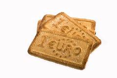 Μπισκότα με τα σύμβολα νομίσματος Στοκ Φωτογραφία