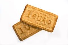 Μπισκότα με τα σύμβολα νομίσματος Στοκ φωτογραφία με δικαίωμα ελεύθερης χρήσης