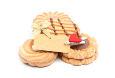 Μπισκότα με τη σοκολάτα και την κενή σημείωση για το άσπρο υπόβαθρο Στοκ Εικόνες