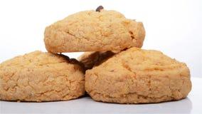 Μπισκότα ξύλων καρυδιάς γεύσης καρύδων που περιστρέφονται την περιστροφή μπισκότων ξύλων καρυδιάς γεύσης καρύδων πλάγιας όψης φιλμ μικρού μήκους
