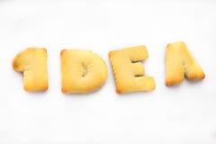 Μπισκότα που τακτοποιούνται στο κείμενο ιδέας για τη δραστηροποίηση των ανθρώπων Στοκ Φωτογραφίες