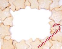 Μπισκότα Χριστουγέννων αστεριών και κάλαμοι καραμελών Στοκ Εικόνες