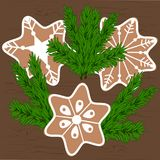 Μπισκότα Χριστουγέννων και κλάδοι χριστουγεννιάτικων δέντρων Στοκ Εικόνα