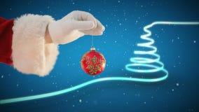 Μπιχλιμπίδι Χριστουγέννων εκμετάλλευσης Santa και χριστουγεννιάτικο δέντρο απόθεμα βίντεο
