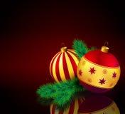 Μπιχλιμπίδια Χριστουγέννων με τον κλάδο έλατου Στοκ Εικόνες