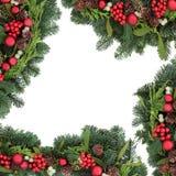 Μπιχλιμπίδι Χριστουγέννων και σύνορα της Holly Στοκ Εικόνα