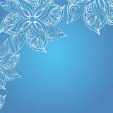 Μπλε ανασκόπηση με τη floral διακόσμηση Στοκ Φωτογραφία