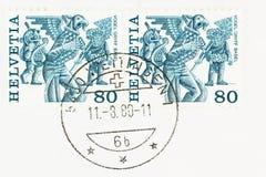 Μπλε και άσπρα γραμματόσημα Ελβετία λαογραφίας στοκ εικόνες