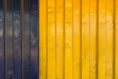 Μπλε και κίτρινη σύσταση εμπορευματοκιβωτίων φορτηγών πλοίων στοκ εικόνα