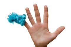 Μπλε καπέλων στο δάχτυλό σας, χιούμορ Χριστουγέννων, απομονωμένο αντικείμενο ΚΑΠ ο Στοκ εικόνα με δικαίωμα ελεύθερης χρήσης