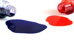 μπλε κόκκινο μελανιού μπουκαλιών που ανατρέπεται Στοκ εικόνες με δικαίωμα ελεύθερης χρήσης