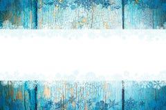 Μπλε ξύλινο όμορφο υπόβαθρο Χριστουγέννων με snowflakes και θέση για το κείμενο στοκ φωτογραφία