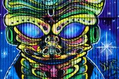 Μπλε παράξενα αλλοδαπά γκράφιτι Στοκ εικόνες με δικαίωμα ελεύθερης χρήσης