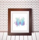 Μπλε πεταλούδα watercolor στο μαύρο πλαίσιο στον άσπρο τουβλότοιχο ελεύθερη απεικόνιση δικαιώματος
