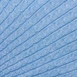 Μπλε πλέκοντας υπόβαθρο υφάσματος Στοκ Φωτογραφίες