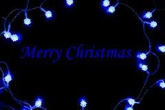 Μπλε πλαίσιο φω'των Χαρούμενα Χριστούγεννας Στοκ Εικόνες