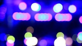 Μπλε, ρόδινα, πορτοκαλιά φω'τα Disco από την εστίαση περίληψη bokeh απόθεμα βίντεο