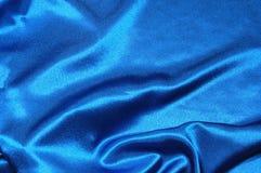 μπλε σατέν ανασκόπησης Στοκ εικόνα με δικαίωμα ελεύθερης χρήσης