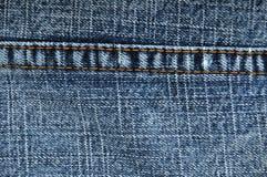 μπλε στενά τζιν που ράβου&n Στοκ Φωτογραφίες