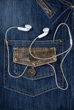 μπλε τζιν ακουστικών Στοκ φωτογραφίες με δικαίωμα ελεύθερης χρήσης