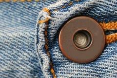 μπλε τζιν κουμπιών Στοκ Εικόνες