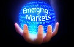Μπλε υποβάθρου σφαιρών ανερχόμενων αγορών Στοκ Φωτογραφίες