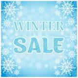 Μπλε υπόβαθρο επιγραφής χειμερινής πώλησης με snowflakes Στοκ Εικόνες