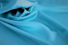 Μπλε υπόβαθρο σατέν Σύσταση, πτυχές στοκ εικόνες με δικαίωμα ελεύθερης χρήσης