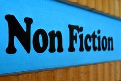 Μπλε υπόβαθρο σημαδιών μη μυθιστοριογραφίας Στοκ Φωτογραφίες