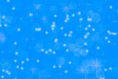 Μπλε υπόβαθρο Χριστουγέννων με τα αστέρια και το χιόνι στοκ φωτογραφία με δικαίωμα ελεύθερης χρήσης