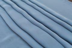 Μπλε textil χρώματος, ύφασμα μεταξιού με τις πτυχές Στοκ εικόνα με δικαίωμα ελεύθερης χρήσης
