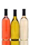 μπουκάλια ανασκόπησης άνω των του άσπρου κρασιού τρία Στοκ Φωτογραφία