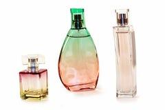 Μπουκάλια αρώματος γυαλιού των διαφορετικών μορφών και των χρωμάτων Στοκ Εικόνα
