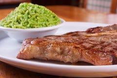 Μπριζόλα και ρύζι χοιρινού κρέατος Στοκ Εικόνες