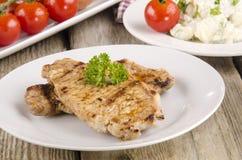Μπριζόλα χοιρινού κρέατος Spicey με το μαϊντανό Στοκ Εικόνες